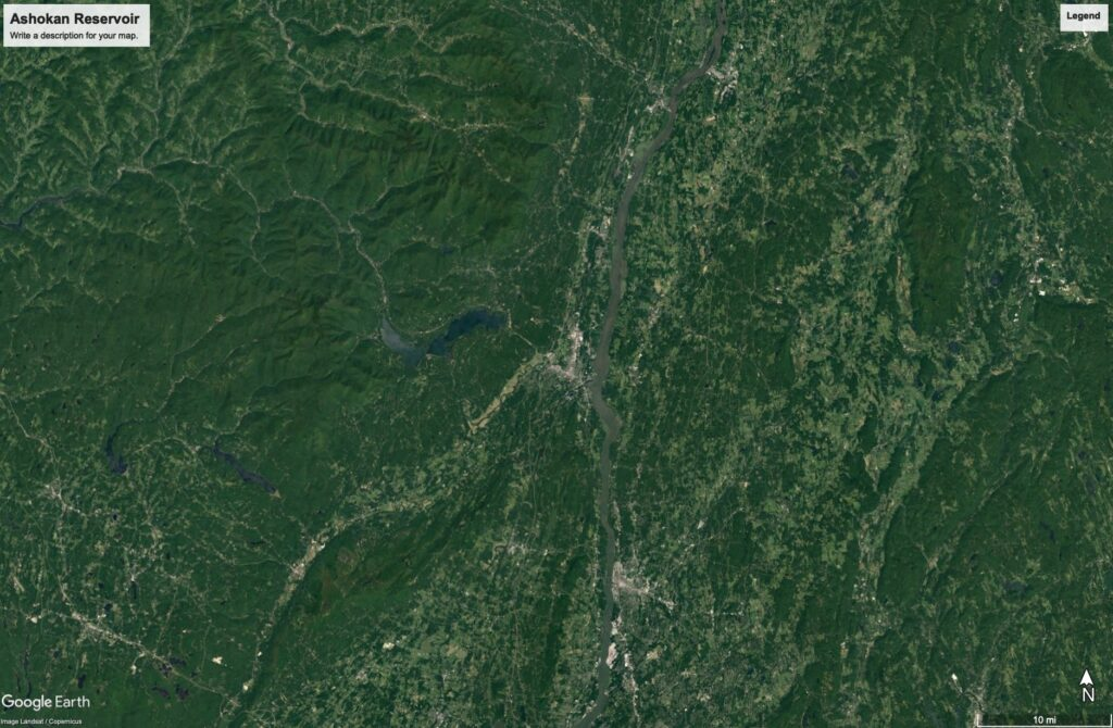 Another satellite image of New York State, slightly more zoomed in than the preceding image. You can mostly just see green topography and you can barely make out a dark blue shape that is the Ashokan Reservoir.