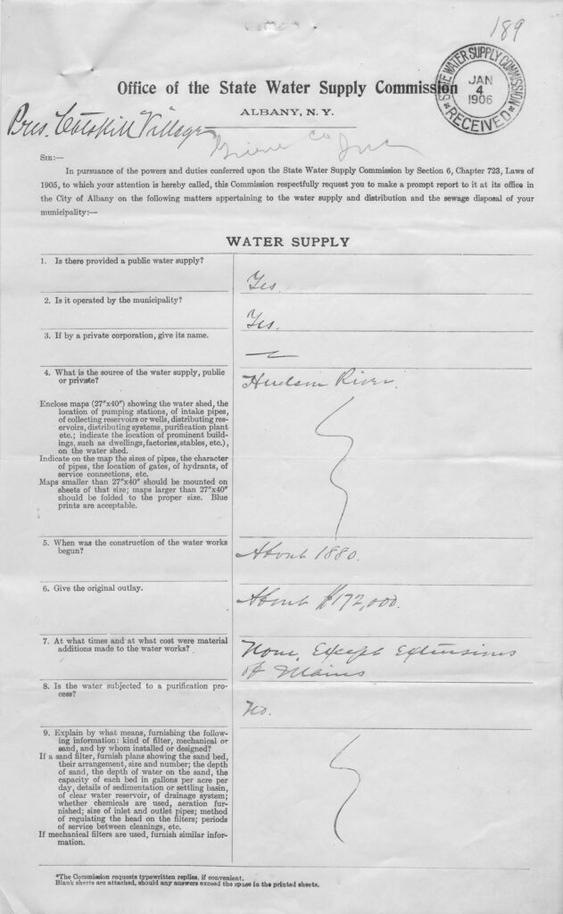 """A photo of a black and white survey document with """"Office of the State Water Supply Commission, Albany NY"""" typed in the heading. The body of the document is unreadable, but it features typed questions on the left and handwritten answers in script on the right."""
