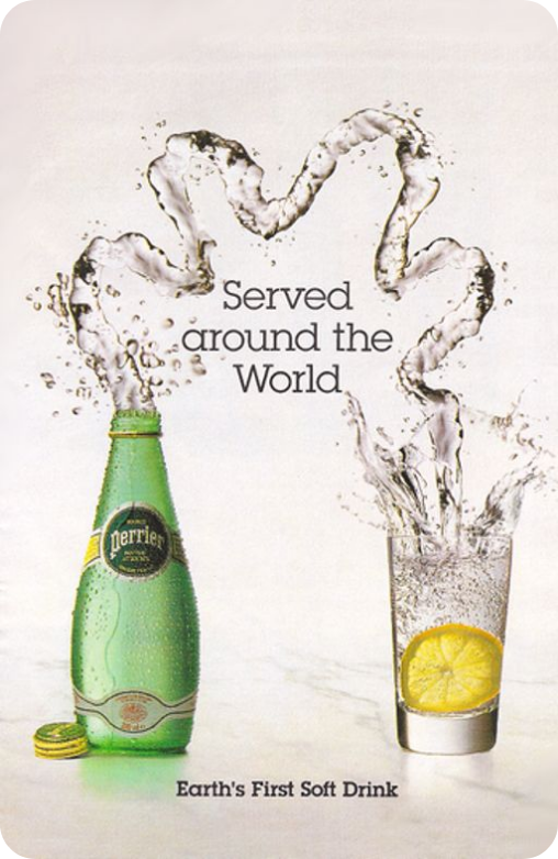 """An advertisement showing a green glass Perrier bottle sitting next to a glass on a white background. There is a squiggly spray of water coming from the mouth of the bottle and splashing into the glass. Text says """"Served around the world"""". Smaller text at the bottom says """"Earth's first soft drink""""."""
